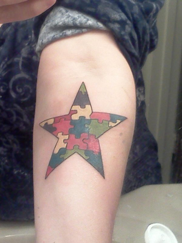 Puzzle Star on Arm Tattoo