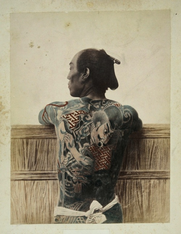Vintage photo of a Japanese wearing a samurai tattoo