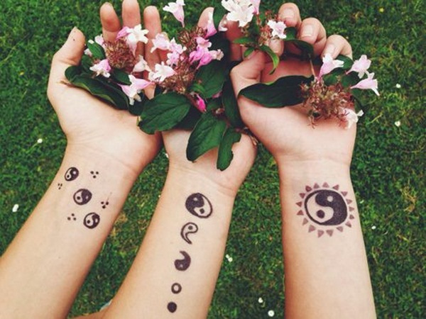 ying yang tattoos on hands
