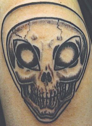 Alien Skull Face Tattoo Design