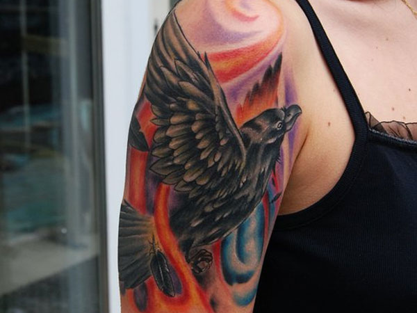 Black Bird Flying Tattoo on Arm